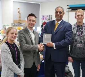 scott-hayden-receiving-the-award-from-bcot-principal-anthony-bravo-with-students-jess-james-and-oliver-cummins-onlinr